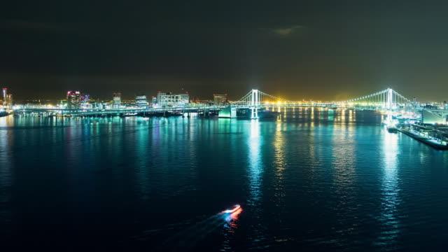 WS T/L View of night scene of rainbow bridge with city skyline / Tokyo, Japan