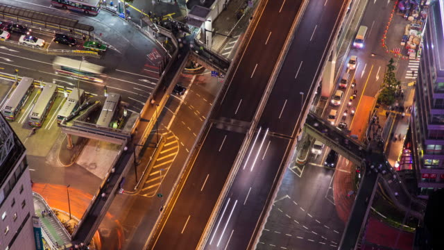MS T/L View of night scene of Shibuya bus station and elevated highway / Tokyo, Japan