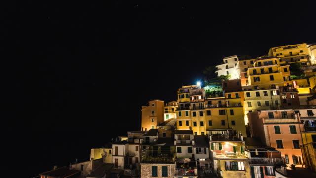 view of night sky and riomaggiore viliage at cinque terre coast - liguria stock videos & royalty-free footage