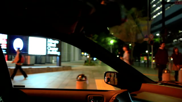 view of night town from passenger seat. - plusphoto stock videos & royalty-free footage