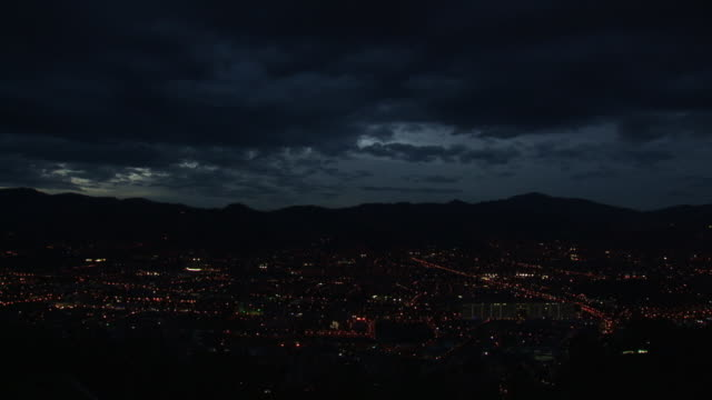 ws t/l view of nightfall with city and clouds / medellin, colombia - medellin colombia stock videos & royalty-free footage