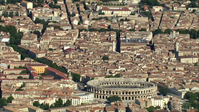 aerial, view of nimes with roman amphitheater, languedoc-roussillon, france - amphitheatre stock videos & royalty-free footage