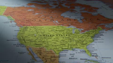 cu pan view of north and south america in world map / atlanta, georgia, usa - kartografi bildbanksvideor och videomaterial från bakom kulisserna