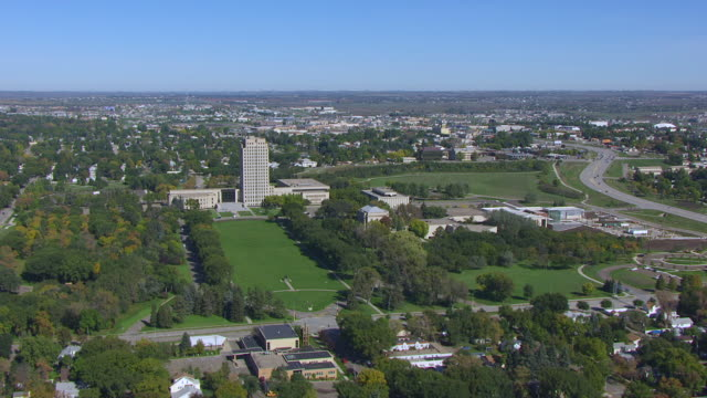 WS AERIAL POV View of North Dakota State Capitol with cityscape / Bismarck, North Dakota, United States