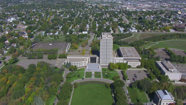 ws aerial pov view of north dakota state capitol with cityscape / bismarck, north dakota, united states - bismarck north dakota stock videos & royalty-free footage