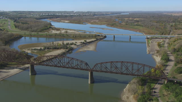 ws aerial pov view of northern pacific railroad bridge over river / bismarck, north dakota, united states - bismarck north dakota stock videos & royalty-free footage