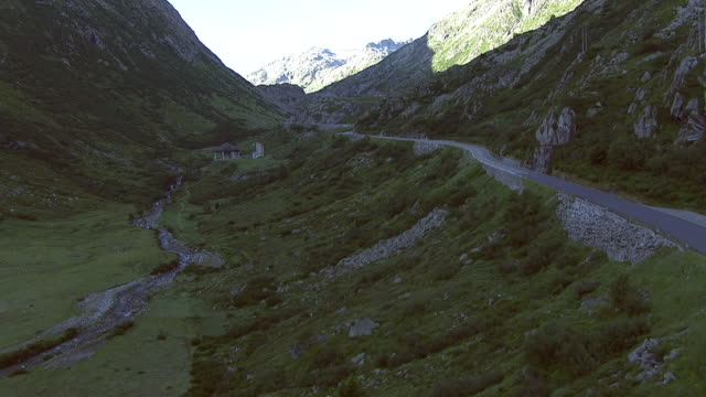 WS AERIAL View of Northern part of gotthard pass road, along gotthardreuss river / Gotthard Pass Road, Uri, Switzerland