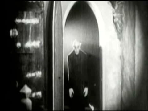 ms view of nosferatu entering in  room / united states - 無声映画点の映像素材/bロール