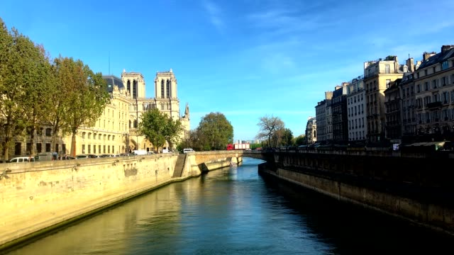view of notre dame after the fire destroyed the spire and roof - spire stock videos & royalty-free footage