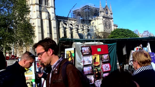 view of notre dame after the fire destroyed the spire and roof - kirchturmspitze stock-videos und b-roll-filmmaterial