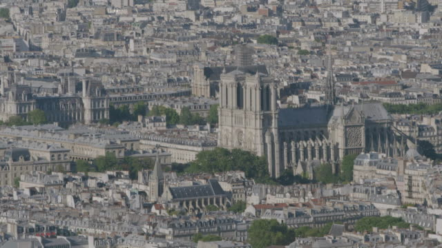 ws aerial view of notre dame de paris and city / paris, france - notre dame de paris stock videos and b-roll footage