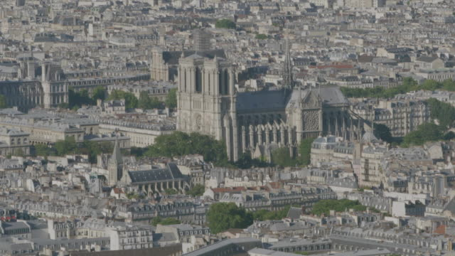 ws aerial tu view of notre dame de paris and city / paris, france - notre dame de paris stock videos and b-roll footage