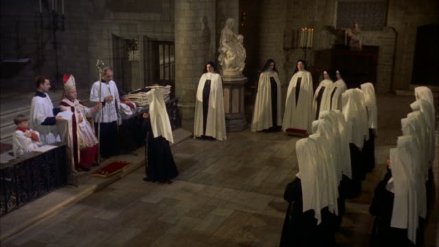 ws view of nuns and bisop standing in 'nuns and bishop in chapel. - clergy stock videos & royalty-free footage