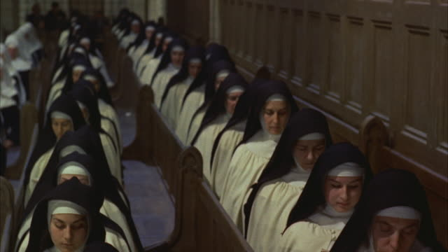 vídeos de stock, filmes e b-roll de ms tu view of nuns with prayer books - nun