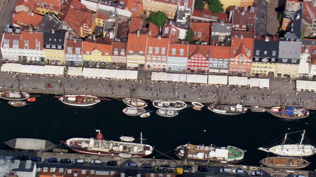 ws aerial zo view of nyhaven and tourist boats / copenhagen, denmark - copenhagen video stock e b–roll