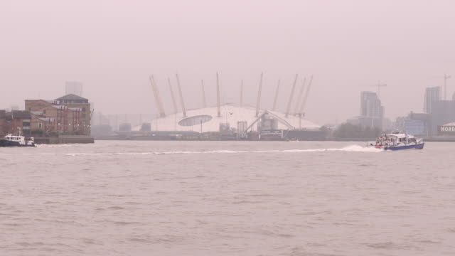 view of o2 arena across the river thames, london - the o2 england stock videos & royalty-free footage