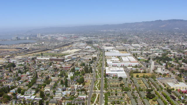 WS AERIAL POV View of Oakland Memorial Park, I-880 freeway and MacArthur Maze overpass / Berkeley, California, United States