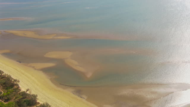 WS AERIAL View of ocean and flying helicopter on ocean / Queensland, Australia