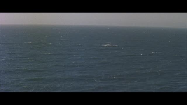 aerial pov view of ocean / ireland - 1957年点の映像素材/bロール