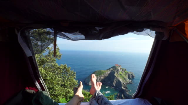 view of ocean out of tent at sunrise - reclining stock videos and b-roll footage