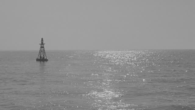 MS POV View of ocean passes buoy
