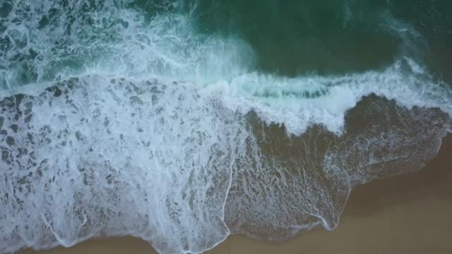 View of ocean waves onto sandy beach in Gyeongpodae (Famous beach in East Sea, South Korea), Gangneung