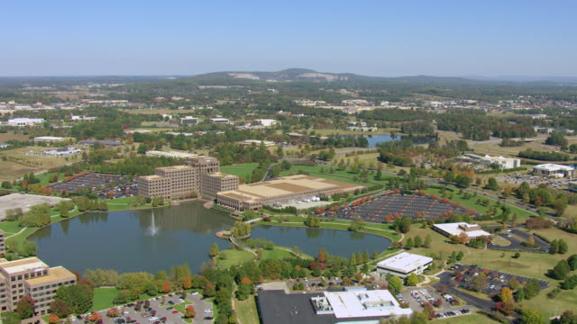 stockvideo's en b-roll-footage met ws aerial view of office park with fountain in lake / huntsville, alabama, united states - alabama