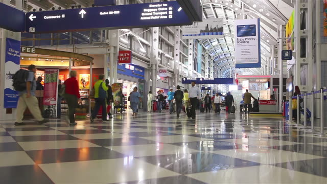 ws la view of o'hare international airport interior with signs and duty free shops / chicago, illinois, united states  - o'hare airport stock videos & royalty-free footage