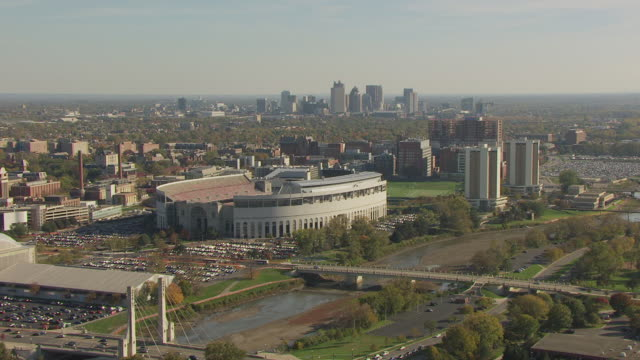 ws aerial view of ohio state football stadium with campus and downtown / columbus, ohio, united states - ohio state university stock videos & royalty-free footage