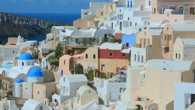 ws view of oia cyclades white buildings with mountains greek islands beautiful peaceful place greek / santorini, greece - oia santorini stock videos and b-roll footage
