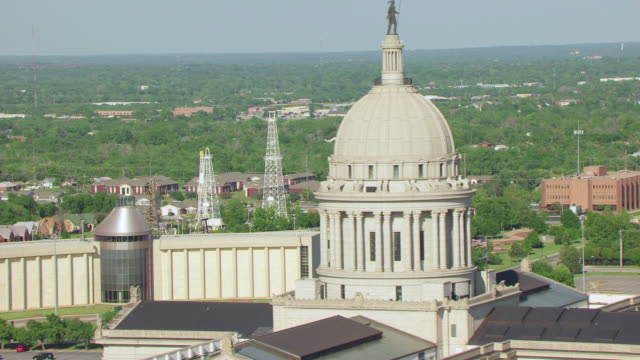 ws aerial view of oil derrick display and oklahoma state capitol building / oklahoma city, oklahoma, united states - oklahoma stock videos & royalty-free footage