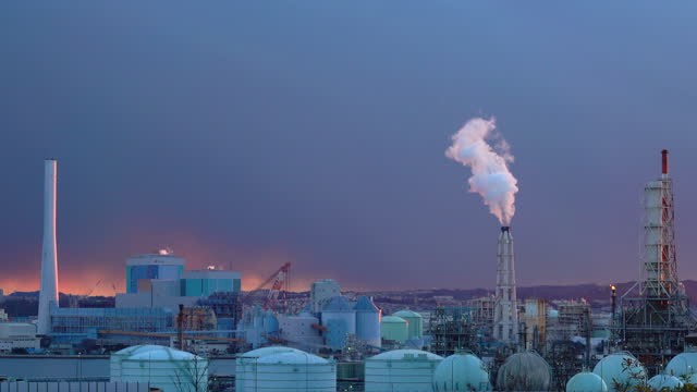 view of oil refinery at dusk. oil and gas industrial - industrial district stock videos & royalty-free footage