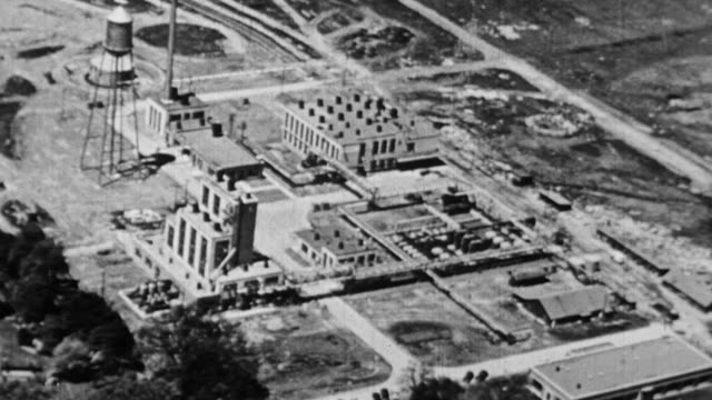 ws aerial view of  oil refinery / united states - 1930 stock-videos und b-roll-filmmaterial