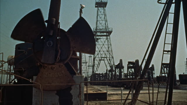 ms view of oil rigging - 1960 stock-videos und b-roll-filmmaterial