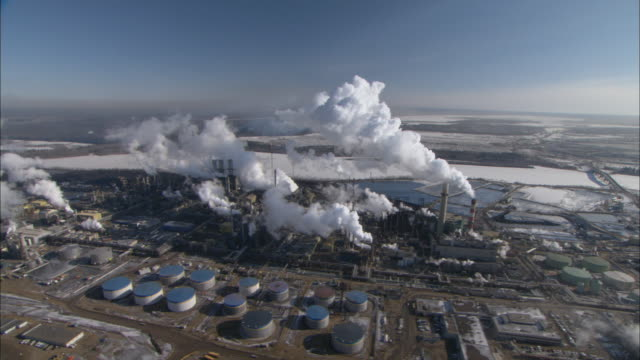 ws pov aerial view of oil sands facility and reserve under blue sky / fort mcmurray, alberta, canada - alberta stock videos & royalty-free footage