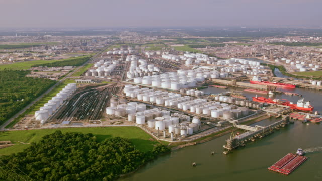 aerial view of oil storage tanks on the buffalo bayou river in houston, tx - silo stock videos & royalty-free footage