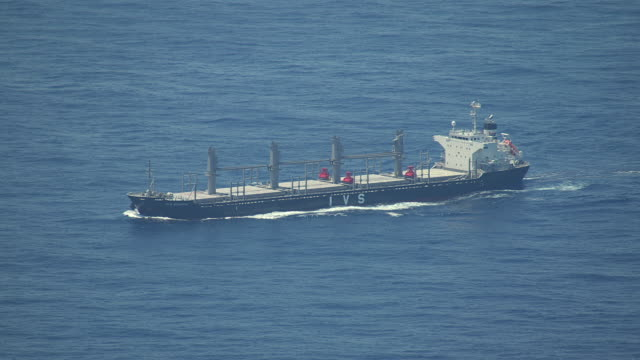 WS AERIAL View of Oil tanker moving in open water / Crete, Peloponnese, Greece