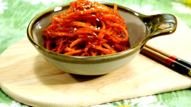 View of Ojingeochaebokkeum (stir-fried dried shredded squid) with sesame seed on top (Popular Korean side dish)