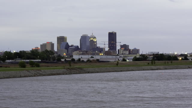 WS ZO T/L View of Oklahoma city skyline across the Oklahoma River from day to night / Oklahoma City, Oklahoma, USA