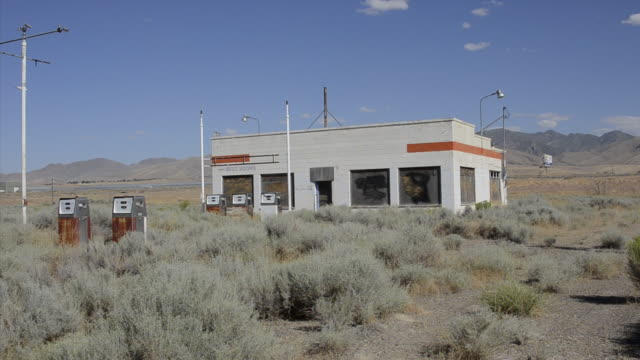 ws view of old abandoned gas station next to busy interstate / winnemucca, nevada, united states - fuel pump stock videos and b-roll footage