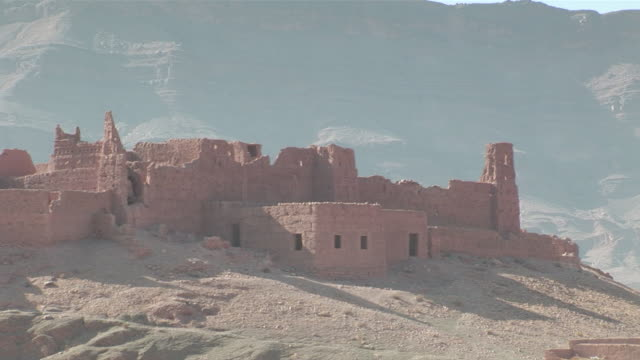 ms pan view of old abandoned ksar in morocco / south morocco, zagora, morocco   - ruine stock-videos und b-roll-filmmaterial