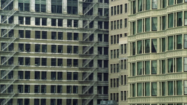 ms view of old and modern office building - fensterfront stock-videos und b-roll-filmmaterial