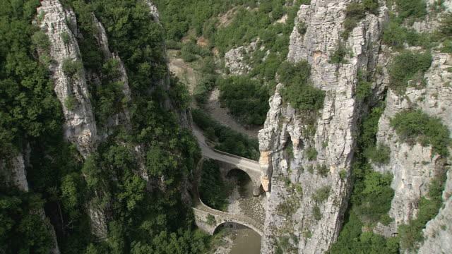 WS AERIAL View of old arc bridge in Vikos Gorge / Epiros, Thessalia, Greece
