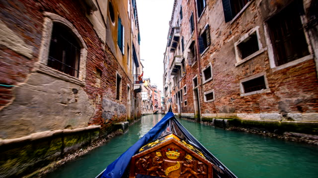 view of old architecture of venice on a gondola (passenger craft) - venice italy stock videos and b-roll footage