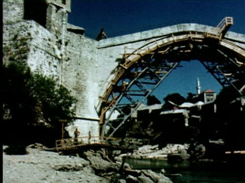 ws pan view of old bridge, belgrade, yugoslavia / audio - bosnia and hercegovina stock videos & royalty-free footage