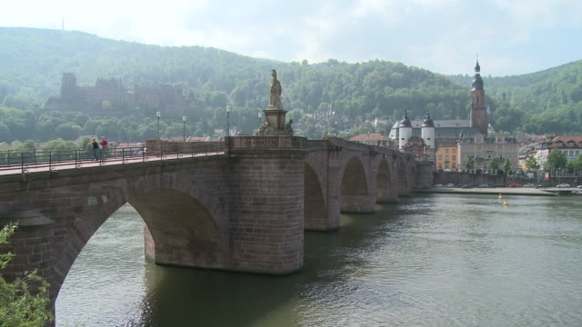ms view of old bridge on river in city and castle in background / heidelberg, baden-wuerttemberg, germany  - heidelberg castle stock videos & royalty-free footage