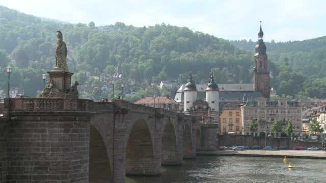 ms view of old bridge on river in city / heidelberg, baden-wuerttemberg, germany  - ハイデルベルク点の映像素材/bロール