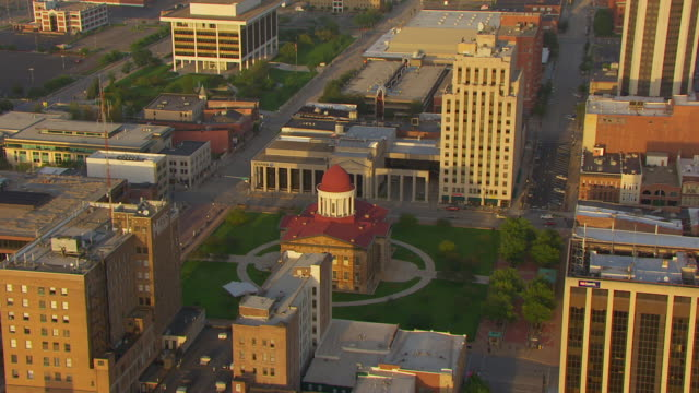 WS AERIAL POV View of old Capitol building in city at sunset / Springfield, Illinois, United States