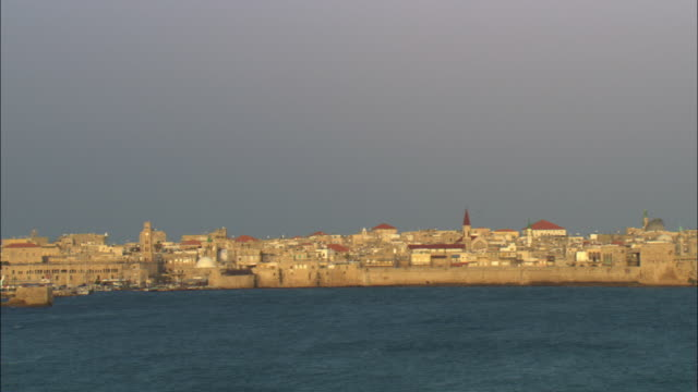 ws pan view of old city of acre across haifa bay / israel - akko stock videos and b-roll footage