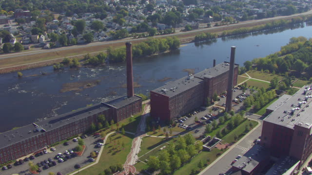 ws aerial pov view of old cotton mills / lowell, massachusetts, united states - lowell stock videos & royalty-free footage